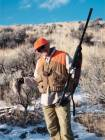 The author's brother with a chukar taken with his heavyweight 12-gauge Browning Gold Hunter semi-automatic shotgun sporting a composite stock