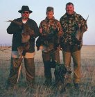 Picture of four Montana pheasants taken late in the afternoon by de tres amigos.