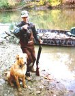 Jason's First Wood Duck.  Jason and Bones pose in front of my duck boat on a northern California river.